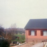 The modern house is looking towards Sombreffe church in the distance.