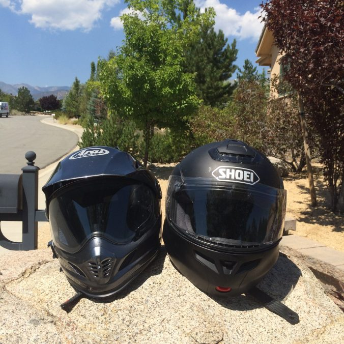 Arai & Shoei Helmets on a rock