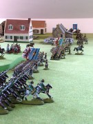 Troops of the Gateway Alliance parade beside Coinville on Henry Hyde's wargames table