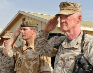 Maj. Gen. Richard Mills, left, salutes during a ceremony at Camp Leatherneck, Afghanistan. (Marine Corps photo)