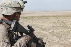 Lance Cpl. Jamenson C. Burgess, of Battalion Landing Team 3rd Battalion, 8th Marines, provides security during a patrol in Amanollah Kariz, Helmand province, Afghanistan, on Feb. 13. (Photo by Sgt. Jesse Johnson/Marine Corps)