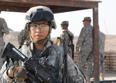 "The Army colonel in charge of that services review on opening combat jobs to women suggested that this photo of Cpl. Kristine Tejeda was too pretty to accompany stories on the topic. She wrote in an internal email that ""ugly women are perceived as competent,"" and public affairs personnel should keep that in mind when illustrating stories on women in combat roles.  ( Pvt. Andrew Slovensky/Army)"