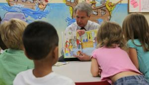 Rep. Walter Jones, seen here in a 2009 photo reading to kids at Naval Hospital Camp Lejeune, N.C. (Photo by Cpl. Jessica L. Martinez/Marine Corps)