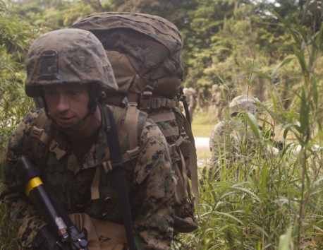 A Marine walks with his pack during Land Force Cooperation Afloat Readiness Training in Okinawa, Japan in March. Credit: Marine Corps