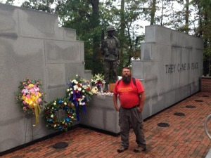 Doolittle stands at the Beirut memorial at the end of his walk. Photo courtesy Doolittle's Facebook page.