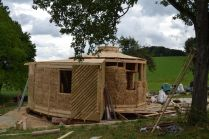 straw bale roundhouse workshop with straw bale insulated reciprocal roof