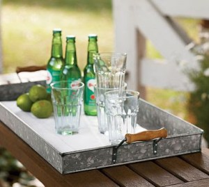 Create a self-serve area using a tray, some glasses and necessary drink ingredients