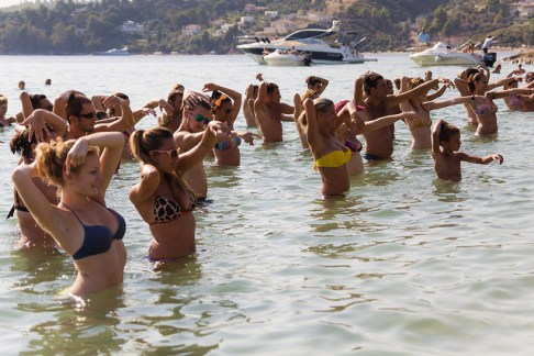 group of people participating in beach aqua aerobics class