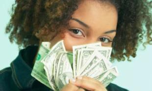 Black woman smelling money