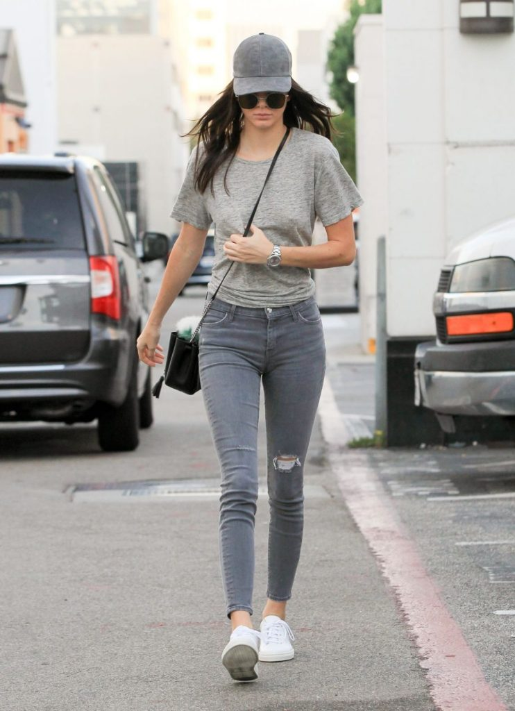 kendall jenner wearing baseball hat on rainy day