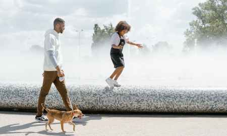 Black family walking their dog