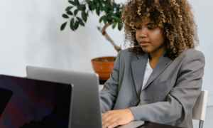 Black woman working on computer