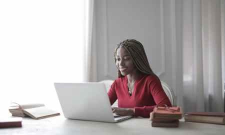 Black woman on computer