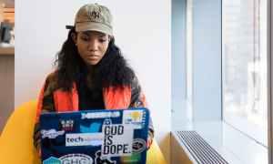 Black woman working on laptop