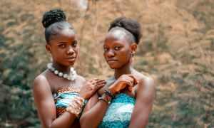 Two African ladies standing beside each