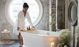 Black woman near bath tub
