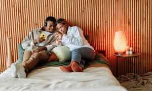 Black couple resting in bedroom