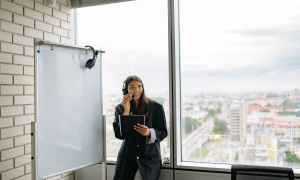 Black woman standing in office
