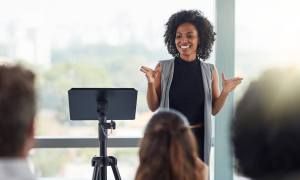 Black woman presenting in front of people