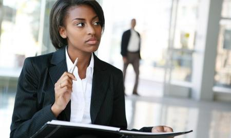 Black business woman thinking while at work