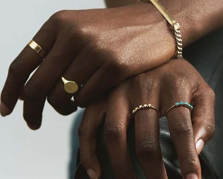 black woman wearing jewelry rings