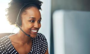 black woman customer experience agent smiling at work