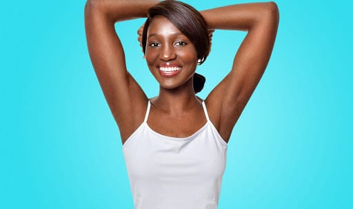 black woman raising arms for laser hair removal treatment