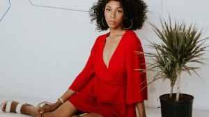 black woman wearing a red dress