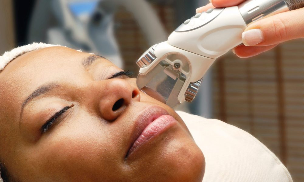black woman getting laser treatment at medical spa