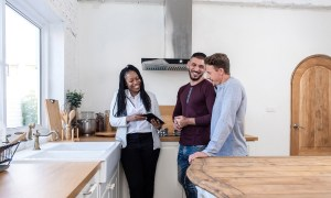 realtor showing home to couple