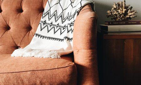 cozy sofa with throw blanket