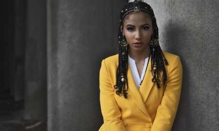 black woman in yellow suit