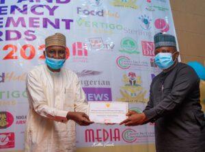 Dr. Sule Yau Sule presents award to Manzo Ezekiel of NEMA