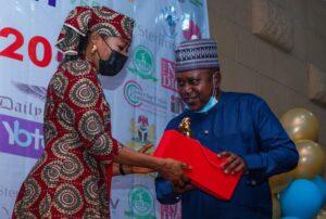 A representative of Profile Security Service receives SAEMA Award
