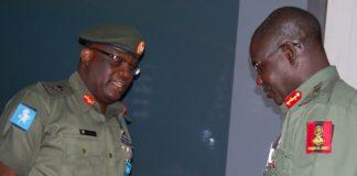 Major General Adeniyi Oyebade submitting a report to Chief of Army Staff, Lieutenant General Tukur Yusuf Buratai
