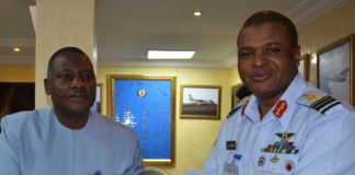 NAF_Boss_Air_Marshall_S_B_abubakar_presenting_souvenir_to_the_chairman_innoson_motors_mr__innocent_chuwkuma