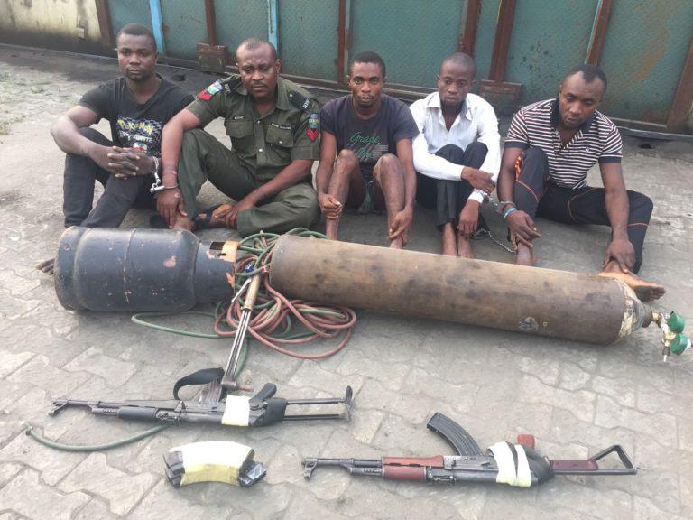 Banker, Security Men Arrested for Armed Robbery