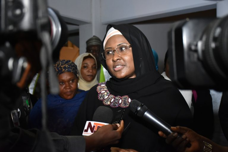 Aisha Buhari returns from the UK, says President is recuperating fast