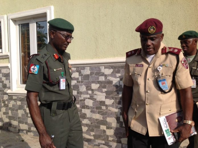 Corps Commander Imoh Etuk with DDI Major General Enenche at FOSSRA Meeting