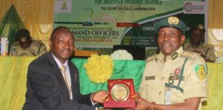 ES CCC Air Commodore Yusuf Anas presents Award to CG NPS Ahmed Ja'afaru