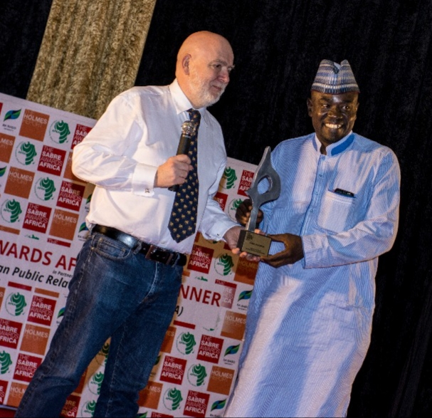 Chair Panel of Judges, Paul Holmes presents SABRE African Public Relations Awards to Yushau Shuaib of PRNigeria in Gaborone Botswana