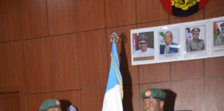 Former Army acting spokesperson, Col. A. Yusuf handing-over to his successor, Col Sagir Musa