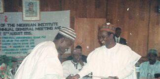Alhaji Abu Gidado Congratulates Yushau Shuaib for emerging PRMan of NIPR in Kano 1995