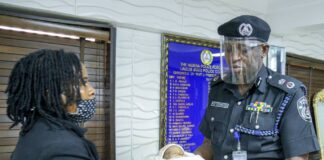 Lagos Police boss with rescued abandoned baby