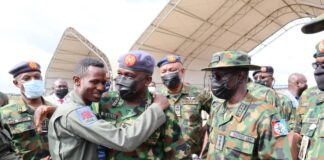 NAF gallant pilot Flight Lieutenant Abayomi Dairo flanked by CDS, CAS and other top military officers