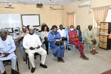 Guests at the unveiling of solar inverter by NYSC Member Umar Farouk Ahmad in an FCT School