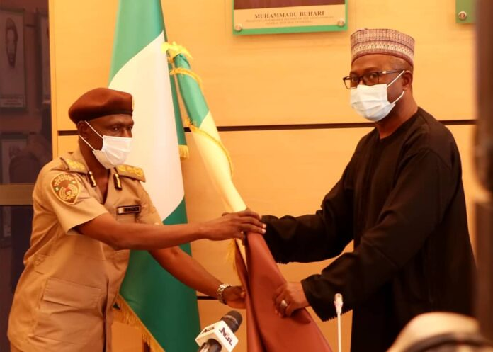 Jere and Babandede of Nigeria Immigration Service NIS