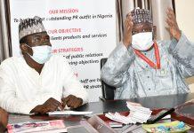 Yushau Shuaib of IMPR listen to BPSR DG Dasuki Ibrahim at PRNigeria Centre Abuja