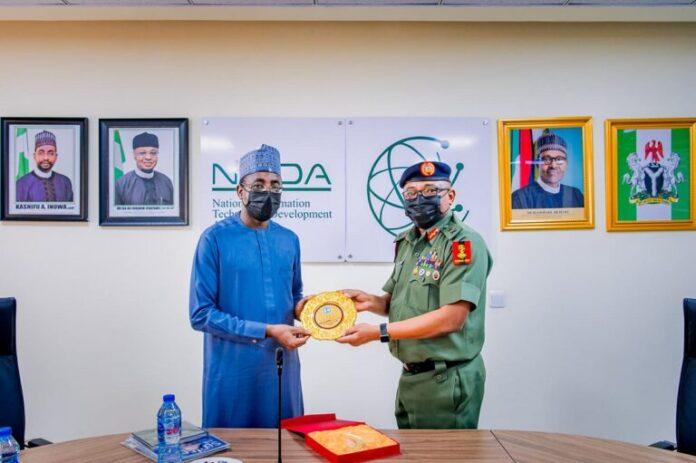 L-R: Director General of NITDA, Mallam Kashifu Inuwa Abdullahi with Chief Of Defense Communication, Nigerian Army, Major General Elvis Njoku