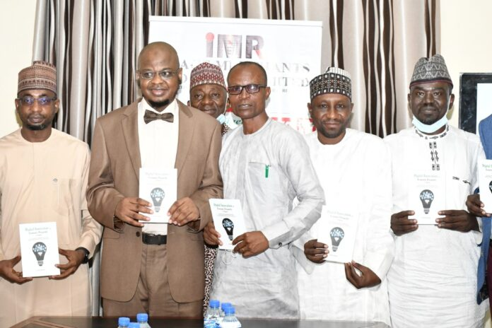 L-R The Minister of communication and digital Economy, Dr. Isa Ali Ibrahim pantami, Book Author, Mr Inyene Ibanga and other dignitaries during the book launch in Abuja